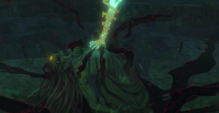 長い髪のミイラとその体内からあふれる瘴気、そしてその胸を掴む青緑色に光る手